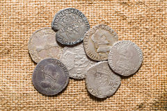 Vintage silver coins with portraits on the old cloth Royalty Free Stock Image