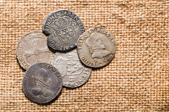 Vintage silver coins with portraits on the old cloth Royalty Free Stock Photography
