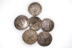 Vintage silver coins with portraits on a white background Royalty Free Stock Photography