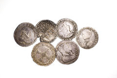 Vintage silver coins with portraits on a white background Royalty Free Stock Image
