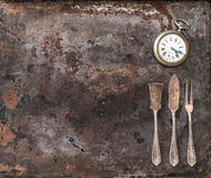 Vintage silver cutlery and antique pocket watch Stock Images