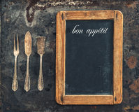 Vintage silver cutlery and blackboard. Retro style Stock Photography