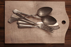 Vintage silver cutlery fork spoon on wooden backdrop ... Stock Image