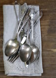 Vintage silver cutlery with linen napkin Stock Image