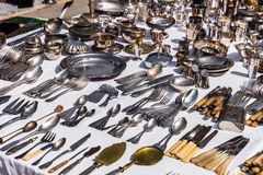 Vintage silver cutlery and tableware at a garage sale at the fle Royalty Free Stock Image