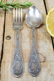Vintage silver fork and spoon on wooden background Royalty Free Stock Image