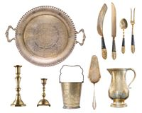 Vintage silver gilded with patterns spoon, fork, knives, candlesticks, tray, jug, spatula for cake, champagne bucket isolated on w. Hite background stock photos