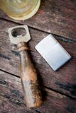 Vintage silver lighter Bottle Opener and Glass of whiskey on Tab Stock Photo