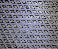 Vintage silver metal surface, grid texture closeup,. Focus on center. vintage silver metal surface, closeup grid texture details Royalty Free Stock Image