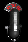 Vintage silver microphone with On The Air Sign Royalty Free Stock Photography
