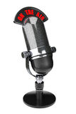Vintage silver microphone with On The Air Sign. On a black background royalty free stock photos