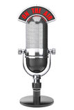 Vintage silver microphone with On The Air Sign. On a white background royalty free stock photo