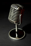 Vintage silver microphone on a black background Royalty Free Stock Photos