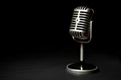 Vintage silver microphone on a black background Stock Images
