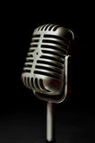 Vintage silver microphone on a black background Stock Photo