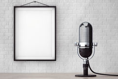 Vintage Silver Microphone in front of Brick Wall with Blank Frame. Extreme closeup stock images