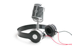 Vintage silver microphone and headphones. The classic vintage silver microphone and headphones stock photos