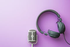 Vintage silver microphone and headphones. The vintage silver microphone and headphones. Top view stock images