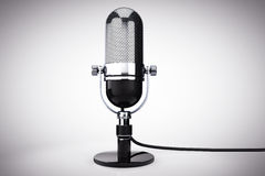 Vintage silver microphone. On a white background royalty free stock photography