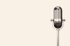 Vintage silver microphone. On a white background royalty free stock photo