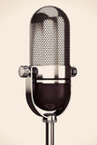 Vintage silver microphone. On a white background stock photography