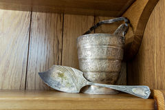 Vintage silver paddle and ice bucket with tongs on a shelf Stock Images