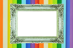 Vintage silver picture frame on colorful wall Stock Photos
