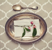 Vintage silver platter and spoon place setting Royalty Free Stock Images