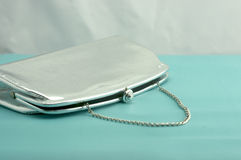 Vintage Silver Purse. Glamorous vintage silver purse on a blue background Royalty Free Stock Images