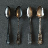 Vintage silver spoons on leather surface. 3d render Royalty Free Stock Image