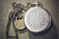 Vintage silver watch on a chain stock image