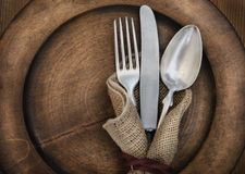 Vintage silverware. On rustick wooden plate Stock Images