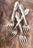 Vintage silverware forks on rustic wooden table Royalty Free Stock Photography