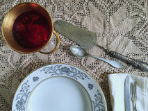 Vintage silverware. And porcelain plates Stock Photography