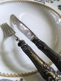 Vintage silverware. And porcelain plates Royalty Free Stock Images
