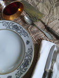 Vintage silverware. And porcelain plates with old goblets Royalty Free Stock Images
