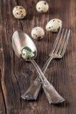 Vintage silverware with quail eggs Royalty Free Stock Photos
