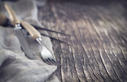 Vintage silverware on rustic background, small depth of field. Royalty Free Stock Photo