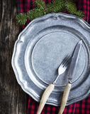 Vintage silverware on rustic metal plate for Christmas Dinner Royalty Free Stock Images
