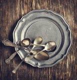 Vintage silverware on rustic metal plate Royalty Free Stock Photo