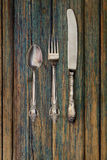 Vintage silverware on rustic wooden background table Royalty Free Stock Photos