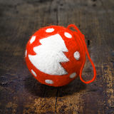 Vintage simple handcrafted Christmas bauble. Red vintage simple handcrafted Christmas bauble with a furry texture decorated with a traditional Christmas tree on Stock Image
