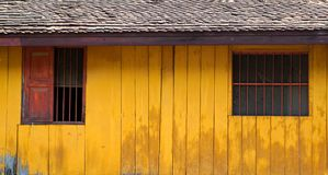Vintage simple wood house with yellow wooden wall and rustic Royalty Free Stock Images