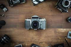 Vintage single lens reflex camera. Vintage camera on a wooden background Royalty Free Stock Images