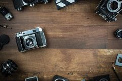 Vintage single lens reflex folding camera. On a wooden background Royalty Free Stock Image