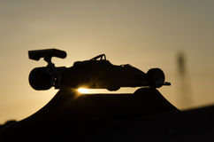 Vintage single-seater with sunset in background. Outline of vintage single-seater with sunset in background royalty free stock image