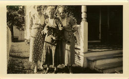 Vintage Sisters Portrait. Vintage photo of three women, one holding an enormous cat Stock Photos