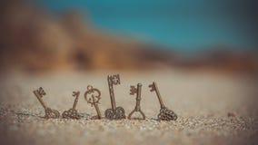 Vintage Skeleton Keys On Beach stock photography