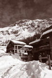 Vintage Ski Chalets. Ski chalets in Val d'Isere, France.  Processed in duotone to create sepia style image Royalty Free Stock Photos