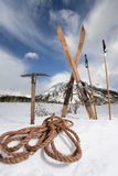 Vintage skis ski poles and ice axe Royalty Free Stock Photos